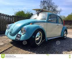 blue volkswagen beetle vintage vw beetle with surfboard editorial stock photo image 72750688