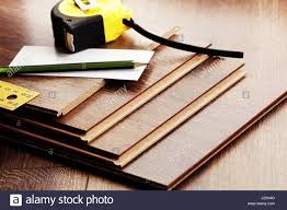 Laminate Floor Planks Laminate Floor Planks And Tools On Wooden Background Stock Photo
