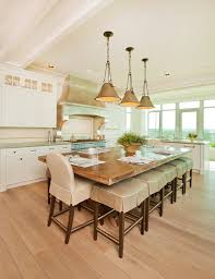 traditional dining room with hardwood floors by craig tuttle