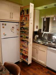 Cabinet Designs For Small Kitchens The Narrow Cabinet Beside The Fridge Pulls Out To Reveal A Spice