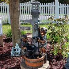 sunnydaze children playing with water faucet outdoor garden