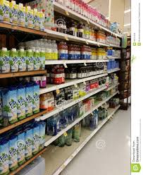 bottles of flavored water on a store shelf editorial photography