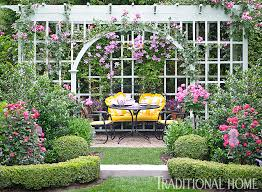 Pictures Of Pergolas In Gardens by A Pergola Covered In Climbing Roses And Clematis Shades An