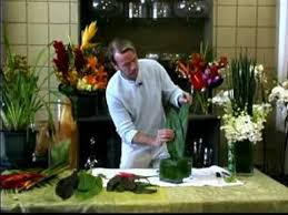 tropical flower arrangements how to make a tropical floral arrangement adding greenery to a