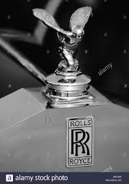 rolls royce logo black and white monochrome shot of a classic rolls royce hood