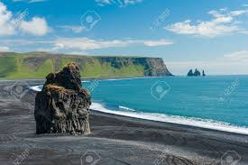 beautiful rock formation on a black volcanic beach at cape