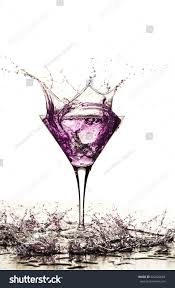 martini glass spilling purple cocktail splash martini glass water stock photo 620420564