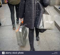 a shopper laden with lord purchases in new york on