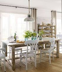 Wicker Light Fixture by Farmhouse Style Dining Room With Wooden Table And White Chairs And