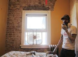 exposed brick the unhandy man s guide to exposing a brick wall and then we saved