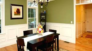 bright traditional dining room with carpet crown molding