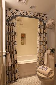 liz caan interiors chic small bathroom design with white blue shower curtains with valance and tiebacks design