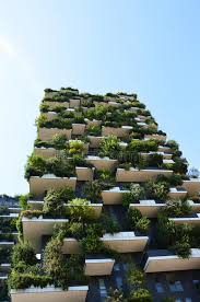 modern and ecologic skyscrapers with many trees on every balcony