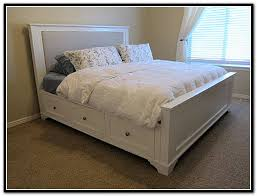 traditional bedroom with king size platform bed storage and dark