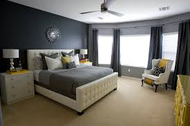 tufted bed bedroom transitional with beige bookcase beige