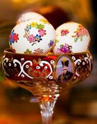haji firooz doll colored eggs are one of the items placed on haft seen table for