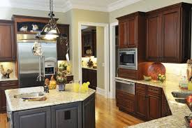 kitchen with dark brown cabinets stainless steel pendant lamp