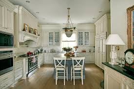 traditional kitchen with complex granite counters u0026 glass panel in