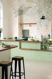 531 best trending graphic walls floors images on pinterest mint and wood kitchen inspiration ministry of the new mumbai cafe monday s large scale mural with coral stripes overlaid with hand drawn monochrome