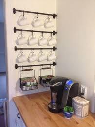 under cabinet coffee mug rack love this idea for under cabinet storage home pinterest