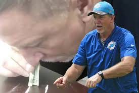dolphins coach resigns damning snorting video surfaces