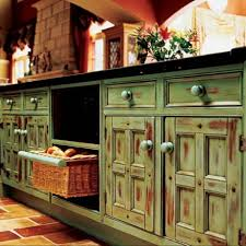 charming distressed green kitchen island with pull out wicker