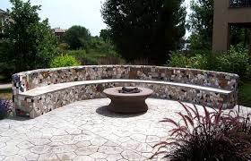 a large semi circular mosaic fire pit seating area bench
