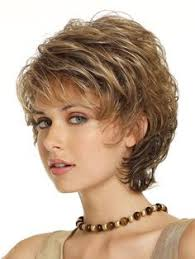 short hairstyles for women in their late 50 s short curly haircut for women over 50 lively curls in razored cut