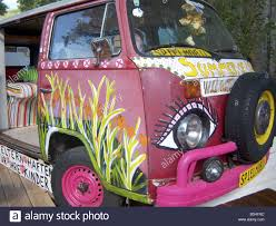 old volkswagen hippie van front detail of old flower child vw bus with lot of hippie