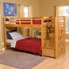 cheap bunk beds with stairs single black chair on wooden floor
