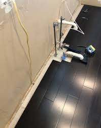 how to raise cabinets the floor should hardwood floors go all the way to wall kitchen
