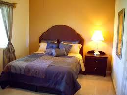 black wooden bed frame white platform bed small master bedroom