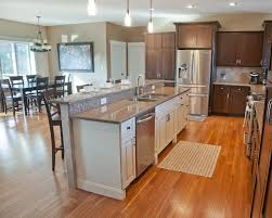 open concept kitchen with hickory stained perimeter cabinetry