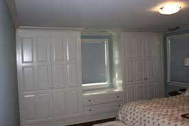 how to build a bedroom how to build closets around a window making a window seat google