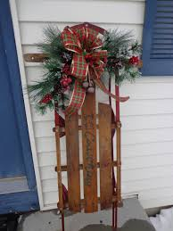 3 feet high flexible flyer sled with cranberry bow jingle bells