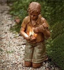 solar garden statue boy with flashlight and frog garden statuary