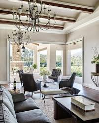 Leather And Wood Coffee Table Black Leather Tufted Chairs Surrounding A Reclaimed Wood
