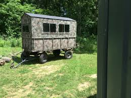 portable deer blind made from dump wagon with sliding camper