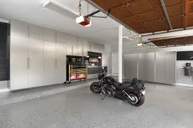 large moden garage house design with silver interior color decor large moden garage house design with silver interior color decor and floor coating epoxy plus wall mounted cabinet and box storage ideas