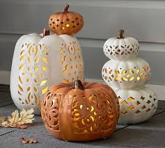 ceramic pumpkins filigree punched ceramic pumpkins pottery barn