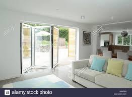 open plan living area with open patio doors stock photo royalty