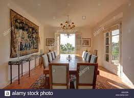 Dining Room Console Table Large Tapestry On Wall Above Glass Metal Console Table In Sunny