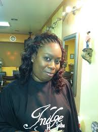 braids in front hair in back braids in the front and sew in weave in the back with indian hair