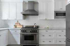 hardware for white shaker kitchen cabinets all white kitchen with white shaker cabinets displays chrome