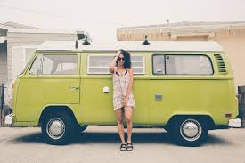 volkswagen bus front woman in front of a green and white volkswagen bus free image peakpx