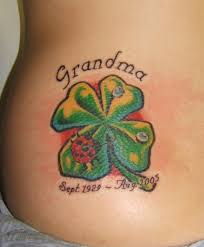 tattoo with family initials four leaf clover tattoo with initials on foot photos pictures and