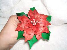 gumpaste poinsettia on lighted cake i wired some branches with a