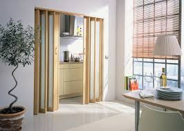 excellent bifold doors as living room divider with handmade blinds