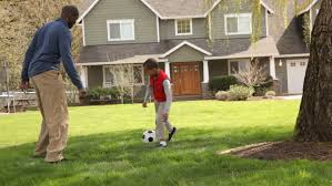 happy asian family sports together in the garden on a