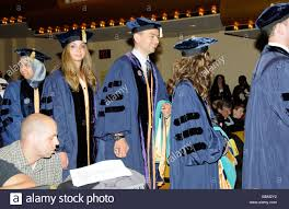 doctoral graduation gown graduation ceremony doctoral graduates wearing cap and gown in